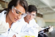Two young scientists making an experiment in a laboratory